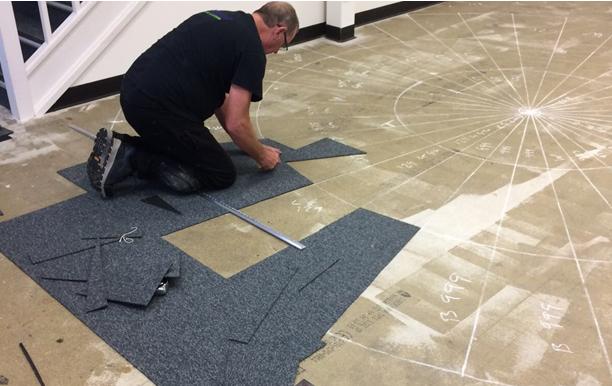 Carpet-Tiles-Being-Installed