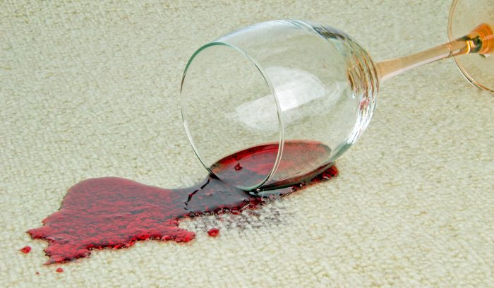 Spilled glass of red wine on a cream carpet