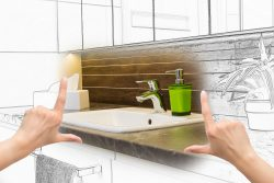 hands framing custom bathroom design. Combination drawing and photo.