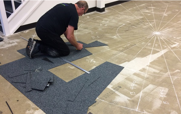 Rivendell install carpet tiles at Crystal maze studios