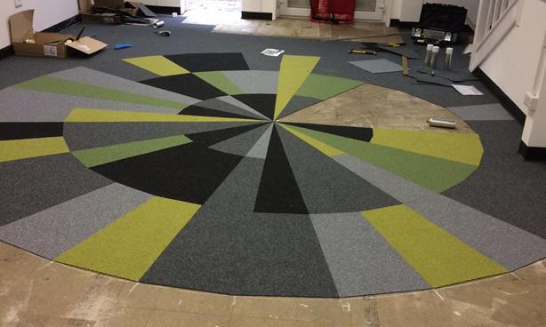 Rivendell install flooring at the crystal maze studios