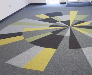 new carpet tiles at the crystal maze main office reception by rivendell flooring